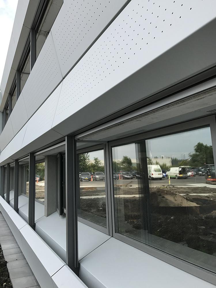 Usynlig Microvent ventilation i glasfacade på Marels domicil